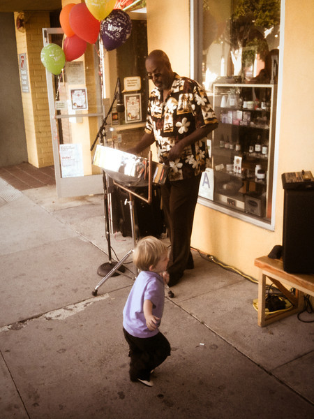 """<span id=""""date"""">_05/21/10_</span> <span id=""""title"""">Dancing Child</span> Gettin' down with da island riddum.  I have no idea why this guy was playing the steel drums in front of a health food store, but it makes for a much more positive photo than the dead raccoon I saw on my walk home. Have a great weekend!  <a href=""""http://www.jawsnap.net/gallery/7157835_BfJPF#542614192_En7fP"""">[last year]</a>"""