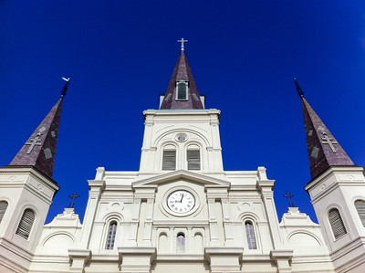 __02/11/11__ Saint Louis Cathedral New Orleans, Day 3 This here be the oldest cathedral in the US. I took the photo from the gate to adjacent Jackson Square in the French Quarter. I like the symmetry, although it makes me wish my phone had an even wider lens :) I spent most of the day in the French Quarter, which was cool. The variety and denseness of the buildings kept my eyes busy. The abundance of wrought iron was impressive. Unfortunately for photography, it was hard to get a good shot of it all, but I guess we'll see when I get back to my computer.  Despite the harsh shadows, it was nice to see the sun, even if it didn't get to 50 (F) degrees.  See a higher-res, wider angle photo of this facade in my New Orleans gallery.  [last year]