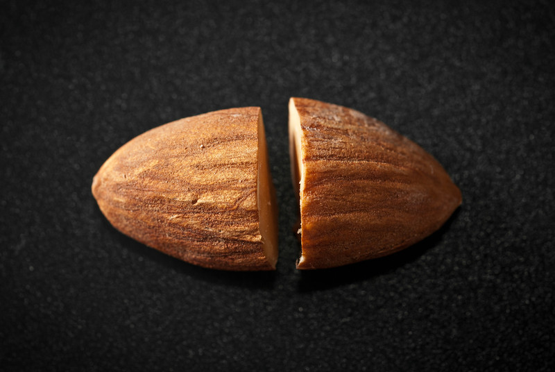 "<span id=""date"">__02/06/11__</span> <span id=""title"">Almond Ball</span> While pondering what sort of desperation shot to take on this Sunday of Super Bowls, it hit me that if I cut two almonds in half and put the pointy ends back to back, it'd look like a football! So... uh... yeah. Here's the amazing result of that eureka moment...   <a href=""http://www.jawsnap.net/Daily/year2/7157835_BfJPF#782703118_NTs59"">[last year]</a>"