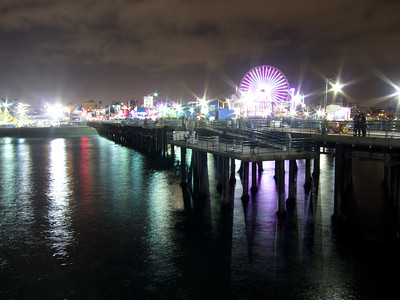 __02/25/12__ Night Pier This is, of course, the Santa Monica Pier, which I've photographed many, many times before. My wife and I got dinner and then walked down here afterwards. I was worried this photo was too similar to one I took 364 days ago, but after comparing the two, I like today's much better. That's good, as my goal is to always be improving. You can't tell in the photo, but there was all sorts of action happening in the water below - I've never seen anything like it. There were hundreds of small fish, or perhaps squid, that were jumping out of the water. They were making little splashes all over the place, but it happened too fast to really see them. Eating the small fish were about 5 sea lions, which would sometimes jump clear out of the water as they chased them, making huge splashes. Most of the folks on the pier were completely unaware that this was happening. It was really cool.  [last year] great balls of neon...