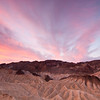 """<span id=""""date"""">_11/24/11_</span> <span id=""""title"""">Zabriskie Sunrise</span> <em>Death Valley, Day 2</em> Happy Thanksgiving! We had a lovely dinner at the posh Furnace Creek Inn in Death Valley. Earlier in the day, we got up for the sunrise at Zabriskie Point, which was full of photographers. This isn't the typical view, but I felt like pointing my camera in a different direction than everyone else - I'm glad for it, as the clouds weren't nearly as neat in the other direction. Zabriskie Point is famous for the way it glows at sunrise, as well as being an awesome view of the colorful badlands in general.  <a href=""""http://www.jawsnap.net/Travel/DeathValley2011/20327429_xbqMPq"""">More Death Valley Photos</a>  <a href=""""http://www.jawsnap.net/Daily/year3/11272102_ACXDJ#1104005286_CtYXb"""">[last year]</a> <em>another other-worldly place...</em>"""