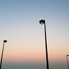 "2013-10-04<br> Three lamps on the top of a parking garage at dusk. You can really see that delicious Los Angeles air. <br>  <br><a href=""http://www.jawsnap.net/Daily/Year5/i-KQk9CmH"">[last year]</a>"