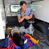CAT<br /> Boulder County animal control officer Brandy Perkins talks to fire and humane society officials about the best way to remove a cat whose head was stuck in a pipe while chasing after a rabbit.<br /> Photo by Marty Caivano/March 23, 2011