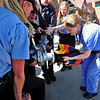 CAT<br /> Boulder County animal control officers, fire and rescue officers, and humane society veterinarians, including Lesli Groshong, right, lift the pipe and its attached cat out of a truck to work on releasing the animal.<br /> Photo by Marty Caivano/March 23, 2011
