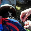 CAT<br /> A veterinarian from the Humane Society of Boulder Valley puts a catheter into a cat whose head in stuck in a pipe, so it can be sedated.<br /> Photo by Marty Caivano/March 23, 2011