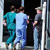 CAT<br /> Veterinarians run into their offices with the cat whose head was stuck in a pipe.<br /> Photo by Marty Caivano/March 23, 2011