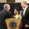 CHAN.jpg University of Colorado Regent Steve Bosley shakes hands with  with CU Chancellor Bud Peterson as his wife Val Peterson looks on during a ceremony announcing Peterson's departure. At far left Phil DiStefano, academic chief of the University of ColoradoÕs Boulder campus, will take over as chancellor, at least temporarily, later this month. The announcement was made on the CU Boulder Campus Thursday afternoon.<br /> Photo by Marty Caivano/March 10, 2009