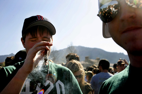 N0421POT.jpg<br /> <br /> A student on Farrand Field on the CU Boulder Campus blocks his face while smoking a blunt of marijuana as part of the 420 celebrations on Thursday, April 20, 2006. Thousands of students gather every year to smoke pot of Farrand Field despite the University's best attempts to stop it.<br /> <br /> Jordan Curet<br /> Thursday, April 20, 2006<br /> Daily Camera