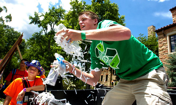 RECYCLE6.JPG Curt Thomas of Northglenn, Colorado digs deep for plastic bottles and cans during the recycling games in the Norlin Quad on the University of Colorado Boulder Colorado on Monday June 29, 2009<br /> Photo Paul Aiken / The Camera / June 29, 2009