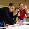 """ORGAN<br /> Anthony Lamirato, right, flashes an a-ok sign to friends and family while adding the finishing touches to a floragraph of his son, Jared, who died almost a year ago and was an organ donor. With Lamirato is his wife, Mary, and son Joshua, who were part of a ceremony at Crist Mortuary to prepare Jared's floragraph for the Donate Life Rose Parade on January 1. <br /> For more photos, see  <a href=""""http://www.dailycamera.com"""">http://www.dailycamera.com</a>.<br /> Photo by Marty Caivano/Camera/Dec. 14, 2010"""