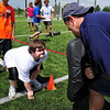 """FOOTBALL<br /> Alex Schwartz, left, prepares to hit Tyler Polumbus, right, a defensive lineman with the Seattle Seahawks, during a camp for people with developmental disabilities on Thursday. The camp was a partnership between the Boulder Parks and Recreation's EXPAND program and """"Tyler's Kids Outreach"""" foundation. <br /> Photo by Marty Caivano/July 7, 2011"""