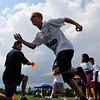 "FOOTBALL<br /> Andy Seely, foreground, sprints off the line at the command of Tyler Polumbus, a defensive lineman with the Seattle Seahawks, during a camp for people with developmental disabilities on Thursday. The camp was a partnership between the Boulder Parks and Recreation's EXPAND program and ""Tyler's Kids Outreach"" foundation. <br /> Photo by Marty Caivano/July 7, 2011"