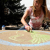 """Kylie Bearse, a CU junior, draws with chalk near the UMC fountain on the CU Boulder campus on Earth Day, April 22, 2010. For more photos, or a video of the earth day festivities on campus visit  <a href=""""http://www.dailycamera.com"""">http://www.dailycamera.com</a><br /> Stephen Swofford  / For The Camera"""