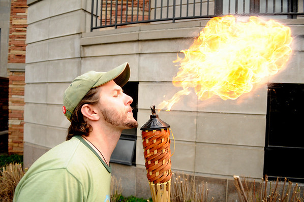 "Josh Maynard, a senior at CU in mechanical engineering, uses biodiesel made from cooking oil from the school to breathe fire on the CU Boulder campus on Earth Day, April 22, 2010. For more photos, or a video of the earth day festivities on campus visit  <a href=""http://www.dailycamera.com"">http://www.dailycamera.com</a><br /> Stephen Swofford  / For The Camera"