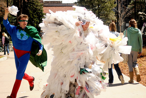 "Scot Woolley, left, chases Dan Omasta, dressed as a bag monster, through the CU Boulder campus on Earth Day, April 22, 2010 to help raise awareness of unsustainable living. For more photos, or a video of the earth day festivities on campus visit  <a href=""http://www.dailycamera.com"">http://www.dailycamera.com</a><br /> Stephen Swofford  / For The Camera"