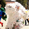 """Scot Woolley, left, chases Dan Omasta, dressed as a bag monster, through the CU Boulder campus on Earth Day, April 22, 2010 to help raise awareness of unsustainable living. For more photos, or a video of the earth day festivities on campus visit  <a href=""""http://www.dailycamera.com"""">http://www.dailycamera.com</a><br /> Stephen Swofford  / For The Camera"""