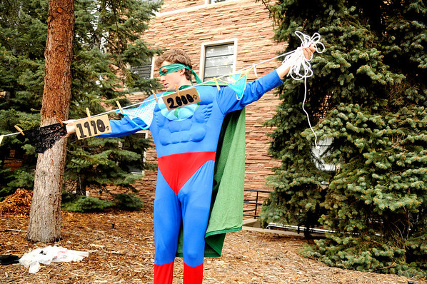 "Scot Woolley, dressed as Captain Planet, sets up a whimsical display of underwear from the past 200 years demonstrating ""proof of global warming"" on the CU Boulder campus on Earth Day, April 22, 2010. For more photos, or a video of the earth day festivities on campus visit  <a href=""http://www.dailycamera.com"">http://www.dailycamera.com</a><br /> Stephen Swofford  / For The Camera"