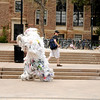 """Dan Omasta, dressed as a bag monster, runs through the CU Boulder campus chased by Scot Woolley, dressed as Captain Planet, on Earth Day, April 22, 2010 to help raise awareness of unsustainable living. For more photos, or a video of the earth day festivities on campus visit  <a href=""""http://www.dailycamera.com"""">http://www.dailycamera.com</a><br /> Stephen Swofford  / For The Camera"""