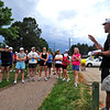 RUNNERS<br /> Scott Fliegelman, right, founder and head coach of FastForward Sports, breaks runners into groups based on their mile pace during a group workout on Tuesday.<br /> <br /> Photo by Marty Caivano/July 6, 2011