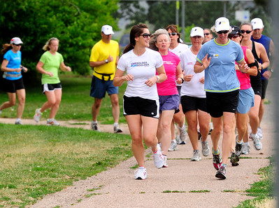 RUNNERS Jean Crowley, right, a coach with FastForward Sports, leads a group of runners in a workout on Tuesday.  Photo by Marty Caivano/July 6, 2011