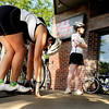 "Cycling for Beginners001.JPG Vanessa Khuong, of Boulder, left, stretches her legs before departing on a club bicycle ride on Sunday, July 17, at Full Cycle Bikes near the intersection of 18th Street and Pearl Street in Boulder. For a video of the Venus de Miles Bike Club go to  <a href=""http://www.dailycamera.com"">http://www.dailycamera.com</a><br /> Jeremy Papasso/ Camera"
