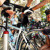 "Cycling for Beginners002.JPG Grace Lee, of Boulder, right, gets some help pumping up her tire by fellow riders before departing on a club bicycle ride on Sunday, July 17, at Full Cycle Bikes near the intersection of 18th Street and Pearl Street in Boulder. For a video of the Venus de Miles Bike Club go to  <a href=""http://www.dailycamera.com"">http://www.dailycamera.com</a><br /> Jeremy Papasso/ Camera"