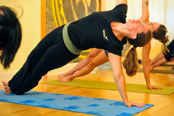 YOGA<br /> Lisa McClear takes a yoga class at Om Time in Boulder.<br /> Photo by Marty Caivano/July 8, 2011