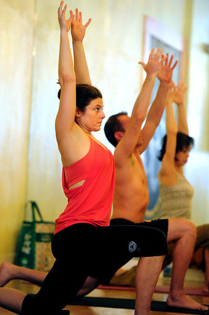 YOGA<br /> Amy Lieberman takes a yoga class at Om Time in Boulder.<br /> Photo by Marty Caivano/July 8, 2011
