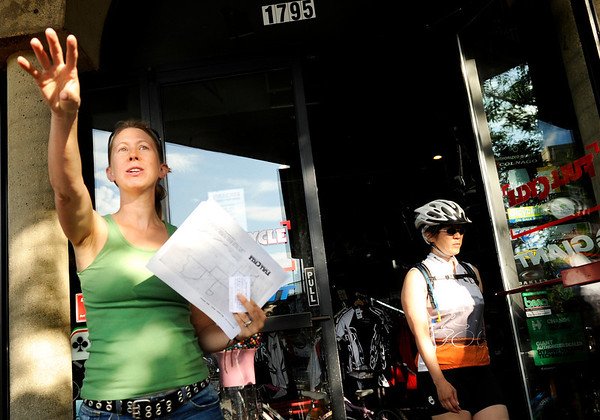 "Cycling for Beginners003.JPG Shop co-owner Tanja Wiant, left, explains the bike routes to participants during a club bicycle ride on Sunday, July 17, at Full Cycle  Bikes near the intersection of 18th Street and Pearl Street in Boulder. For a video of the Venus de Miles Bike Club go to  <a href=""http://www.dailycamera.com"">http://www.dailycamera.com</a><br /> Jeremy Papasso/ Camera"
