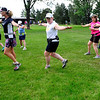 RUNNERS<br /> Heather Forsyth, center, a new triathlete, works out with a FastForward Sports running group on Tuesday. At left is coach Kat Greaney.<br /> Photo by Marty Caivano/July 6, 2011