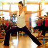 YOGA<br /> Kate Sciolino teaches a yoga class at Om Time in Boulder. <br /> Photo by Marty Caivano/July 8, 2011