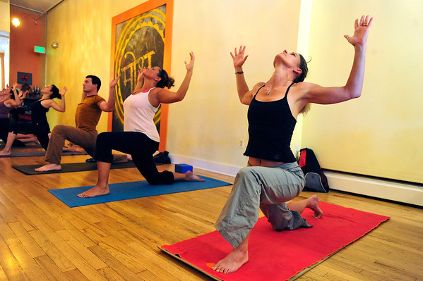 YOGA<br /> Lauri Beckwith, right, takes a yoga class at Om Time in Boulder. From left are Raquel Mayorga, Chad Fatino and Seva Kouremetis.<br /> Photo by Marty Caivano/July 8, 2011