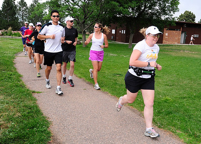 RUNNERS Heather Forsyth, right, a new triathlete, works out with a FastForward Sports running group on Tuesday.  Photo by Marty Caivano/July 6, 2011