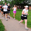 RUNNERS<br /> Heather Forsyth, right, a new triathlete, works out with a FastForward Sports running group on Tuesday.<br /> <br /> Photo by Marty Caivano/July 6, 2011
