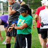 RUNNERS<br /> Ine Salazar, center, sets her watch before starting a run with a group organized by FastForward Sports. Although Salazar has been running for years, she is new to group training.<br /> <br /> Photo by Marty Caivano/July 6, 2011