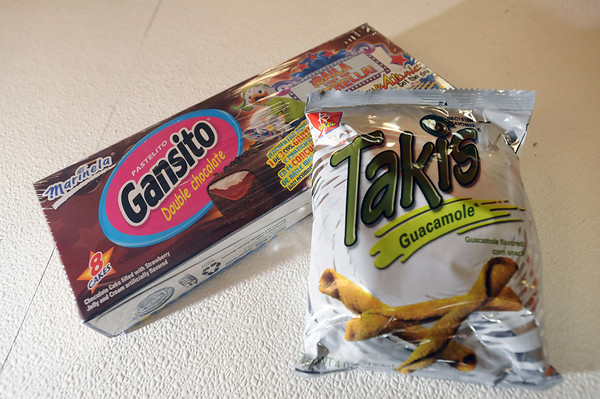 """HISPANIC<br /> Sweet snack: Gansito Marinela Pastelitos, $2.99 for a box of eight. Put these little cakes in the fridge and try them cold. The double chocolate cakes are filled with strawberry jelly and cream.  """"Like a hard, dark Twinkie with a chocolate shell,"""" Camden says. <br />      <br /> Salty snack: Takis Mini Rolled Corn Tortilla Chips, $1.99 per bag. These mini fried corn tortillas come in different flavors: guacamole, salsa, Crunchy Fajita (taco flavored), fuego (extra hot) and Nitro (chile and lime).  <br /> Photo by Marty Caivano/Camera/Sept. 2, 2010"""