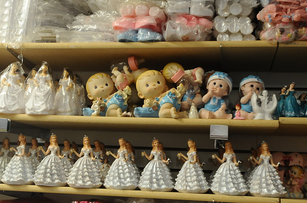 HISPANIC<br /> Cake toppers and other small items on display at Novedad Latina.<br /> Photo by Marty Caivano/Camera/Sept. 2, 2010
