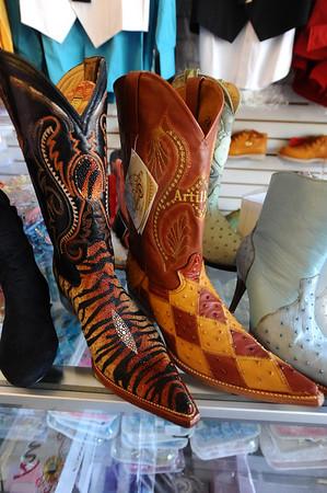 HISPANIC<br /> Cowboy boots on display at Novedad Latina.<br /> Photo by Marty Caivano/Camera/Sept. 2, 2010