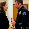 Judy Pease, left, receives condolences from Boulder deputy police chief David Hayes after a memorial service for her husband, longtime BPD officer Mike Pease. The service was held Friday morning at the Sacred Heart of Jesus Church in Boulder. <br /> Photo by Marty Caivano/Feb. 18, 2011