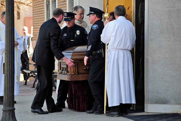 Boulder Police officers carry the casket after a memorial service for long-time Boulder Police Officer Mike Pease. The service was held Friday morning at the Sacred Heart of Jesus Church in Boulder. <br /> Photo by Marty Caivano/Feb. 18, 2011