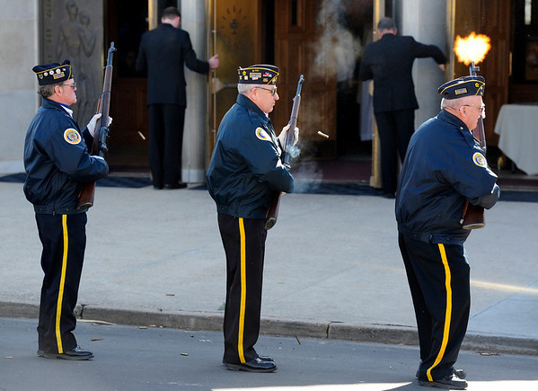 Longtime Boulder Police officer Mike Pease's memorial is concluded with a 21-gun salute on Friday. The service was held at the Sacred Heart of Jesus Church in Boulder. <br /> <br /> Photo by Marty Caivano/Feb. 18, 2011