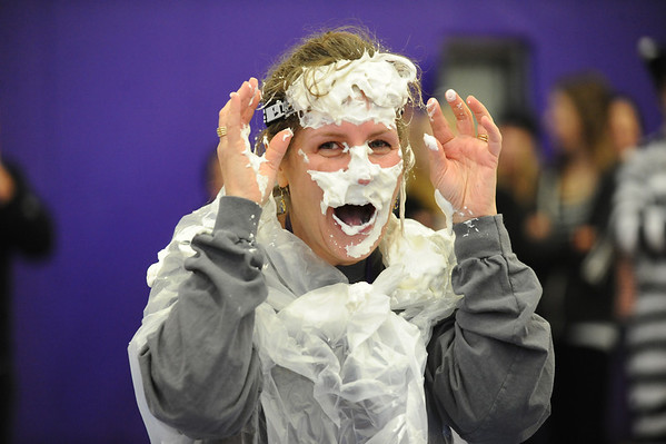 PIE<br /> Shannon Minch, an administrator at Boulder High School, reacts after being hit with a pie to the face during the school's Winter Rally on Tuesday. The pie-throwing event raised money for the Adopt-A-Family program.<br /> Photo by Marty Caivano/Camera/Dec. 1, 2010