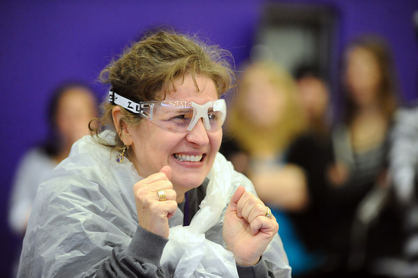 PIE<br /> Shannon Minch, an administrator at Boulder High School, braces herself to take a pie to the face during the school's Winter Rally on Tuesday. The pie-throwing event raised money for the Adopt-A-Family program.<br /> Photo by Marty Caivano/Camera/Dec. 1, 2010