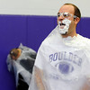 PIE<br /> Brian Donaldson, a math teacher at Boulder High School, samples the results after taking a pie to the face during the school's Winter Rally on Tuesday. The pie-throwing event raised money for the Adopt-A-Family program.<br /> Photo by Marty Caivano/Camera/Dec. 1, 2010