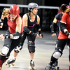 "ROLLER04<br /> Gabrielle ""Fonda Payne"" Begeman, jammer for the Bad Apples, skirts the pack on the outside during a roller derby scrimmage at the 1st Bank Center in Broomfield.  <br /> Photo by Marty Caivano/Camera/March 15, 2010"