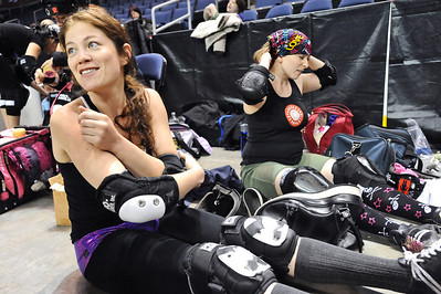 "ROLLER01 Danica ""Berlin Brawl"" Dolezal, left, and Amy ""Moira Lee DeVoid"" Little prepare for a roller derby scrimmage at the 1st Bank Center in Broomfield. An official bout will take place at 7pm on Saturday. Photo by Marty Caivano/Camera/March 15, 2010"