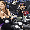 "ROLLER01<br /> Danica ""Berlin Brawl"" Dolezal, left, and Amy ""Moira Lee DeVoid"" Little prepare for a roller derby scrimmage at the 1st Bank Center in Broomfield. An official bout will take place at 7pm on Saturday.<br /> Photo by Marty Caivano/Camera/March 15, 2010"