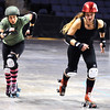 "ROLLER06<br /> Jammers Julie ""Angela Death"" Adams, left, and Gabrielle ""Fonda Payne"" Begeman sprint off the line during a roller derby scrimmage at the 1st Bank Center in Broomfield.  <br /> Photo by Marty Caivano/Camera/March 15, 2010"