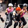 "ROLLER09<br /> Teresa ""Wicked Sister"" Rusk, center, of the Bad Apples, gets some contact from Monica ""Lynn Sane"" Carson, left, and Bobbi ""Bruise-Shea"" Mastalka, right, of the Shotgun Betties, during a roller derby scrimmage at the 1st Bank Center in Broomfield.  <br /> Photo by Marty Caivano/Camera/March 15, 2010"