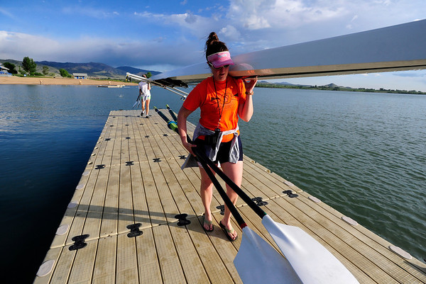 ROWING<br /> Julie Cunningham, front, and Caitlin Crouch, members of Boulder Community Rowing, carry their boat out of the water after training at the Boulder Reservoir on Tuesday morning. Many rowers are working out in anticipation of the Boulder Sprints, a rowing regatta taking place later this month.<br /> Photo by Marty Caivano/June 14, 2011